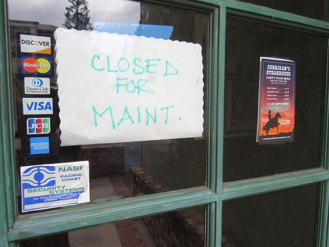 "A ""closed for maint."" sign greets would-be diners at Corrigan's Steakhouse in Thousand Oaks. The nearly 40-year-old restaurant is slated to reopen under new ownership."