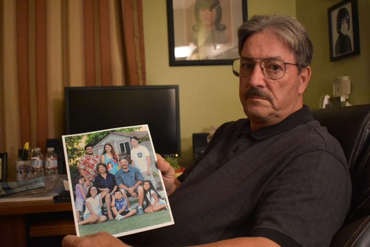 Tom Xedos shows a family picture of his wife, Virginia. She died Dec. 10. Test confirmed that she had caught valley fever.