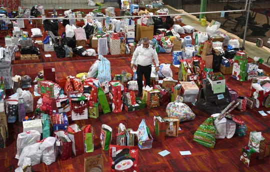 Some of the Christmas toys collected at the Salvation Army in Vineland. Salvation Army Major America Miguel Barriera helps organize all of the gifts on Friday, December 21, 2018.