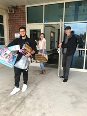 Cumberland County Technical Education Center's Interact Club partnered with the Vineland Salvation Army for its eighth annual Holiday Toy Drive. Students  helped load the toys on the Salvation Army's van.