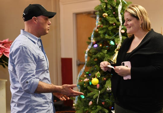 Salvation Army Vineland case manager Aubrie Bonestell accepts a check from David Cavagnaro, President of the Police Benevolent Association on December 21, 2018.