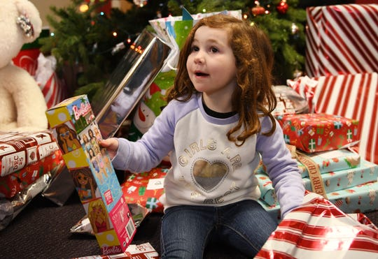 Olivia Hines, 4, holds a gift that she received at the Salvation Army in Vineland on Friday, December 21, 2018.