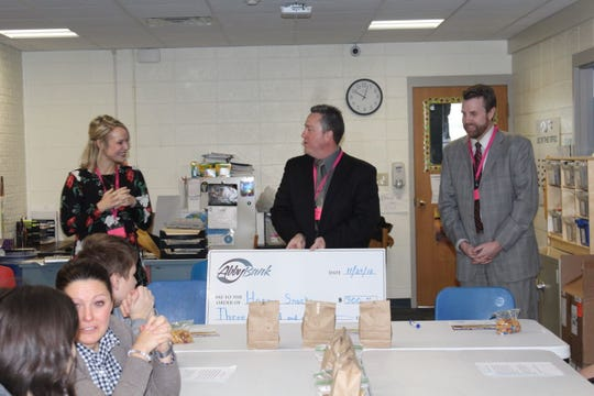 AbbyBank representatives presented a $300 loan for a D.C. Everest student enterprise called Happy Snacks.