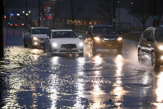 One to 2 inches of rain and strong winds overnight have caused some isolated flooding and a smattering of power outages in Central and North Jersey this morning.