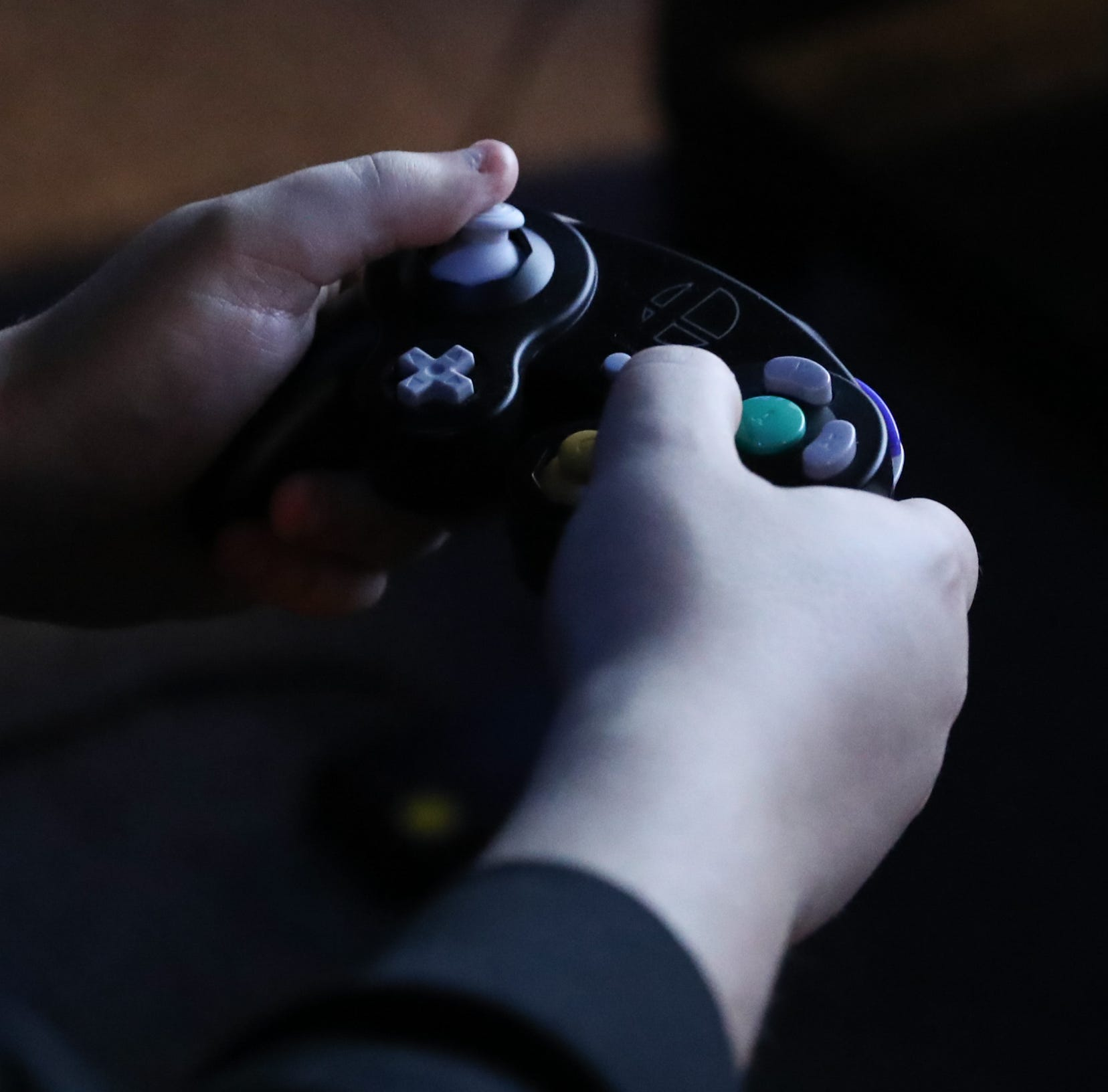 The hands of an esport gamer clutching the controler at Encore Esports Gaming Lounge in New Rochelle on Thursday, December 20, 2018.