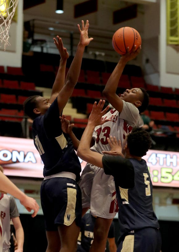 Ronald Greene Jr. of Iona Prep shoots during a Slam Dunk Basketball Tournament championship game against the Newburgh Free Academy at the Westchester County Center in White Plains Dec. 20. 2018. Iona Prep defeated Newburgh 65-62.