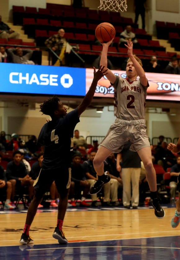 Will Rubin of Iona Prep shoots over Jah'likai King of the Newburgh Free Academy to the loose ball during a Slam Dunk Basketball Tournament championship game at the Westchester County Center in White Plains Dec. 20. 2018. Iona Prep defeated Newburgh 65-62.