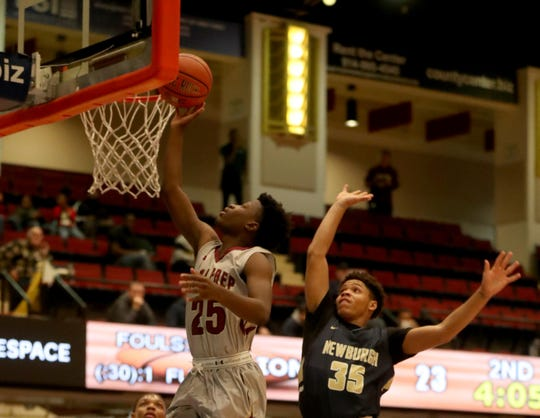 Keshawn Jones of Iona Prep drives to the basket past Isreal Williams of the Newburgh Free Academy during a Slam Dunk Basketball Tournament championship game at the Westchester County Center in White Plains Dec. 20. 2018. Iona Prep defeated Newburgh 65-62.