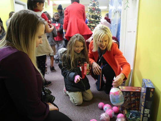 Lt. Governor Bethany Hall-Long helps with a toy giveaway for children at the Knollwood Community Center, where a health initiative included offered the opioid overdose treatment Narcan to adult residents to have available in case of emergency.