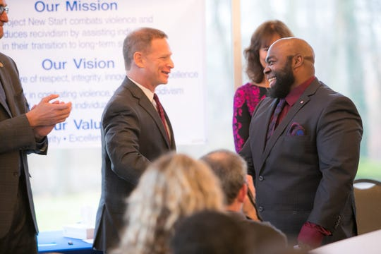 Attorney General Matt Denn congratulates Anthony Miller who graduates from the Project New Start program, a re-entry program for New Castle County residents who spent time in prison.