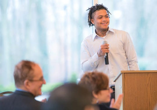 Program graduate Dontel Banice takes a moment to thank family and friends. Project New Start, a re-entry program for New Castle County residents who spent time in prison, hold a graduation ceremony at Widener University Delaware Law School.