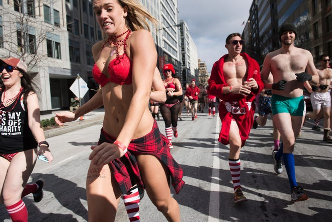 """People run in """"Cupid's Undie Run"""" in Washington, D.C. The annual event expands to 40 cities in February, including at The Queen in Wilmington.  Participants run in their Valentine's-themed underwear, raising funds for the Children's Tumor Foundation."""