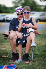 Paul Henretty and Gio Henretty, 6, pose for a photo. The City of Newark holds its Fourth of July fireworks celebration at the University of Delaware Athletic Complex in 2018.