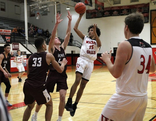 Wichita Falls High School's Isaiah Johnson shoots over Bowie's Jed Castles Thursday, Dec. 20, 2018, at Old High.