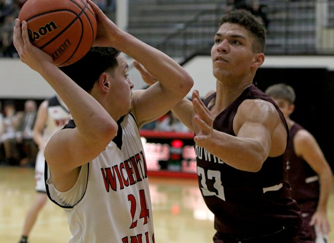 Bowie's Daniel Mosley reachs in to attempt to take the ball from Wichita Falls High School's Kobe Graham Thursday, Dec. 20, 2018, at Old High.
