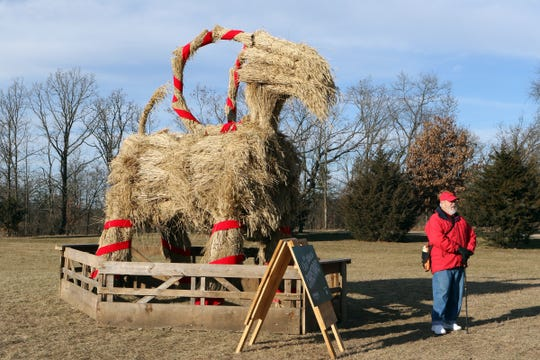 Visitors at Old World Wisconsin in Eagle stop to get a photo with the outdoor musuem's Yule goat.