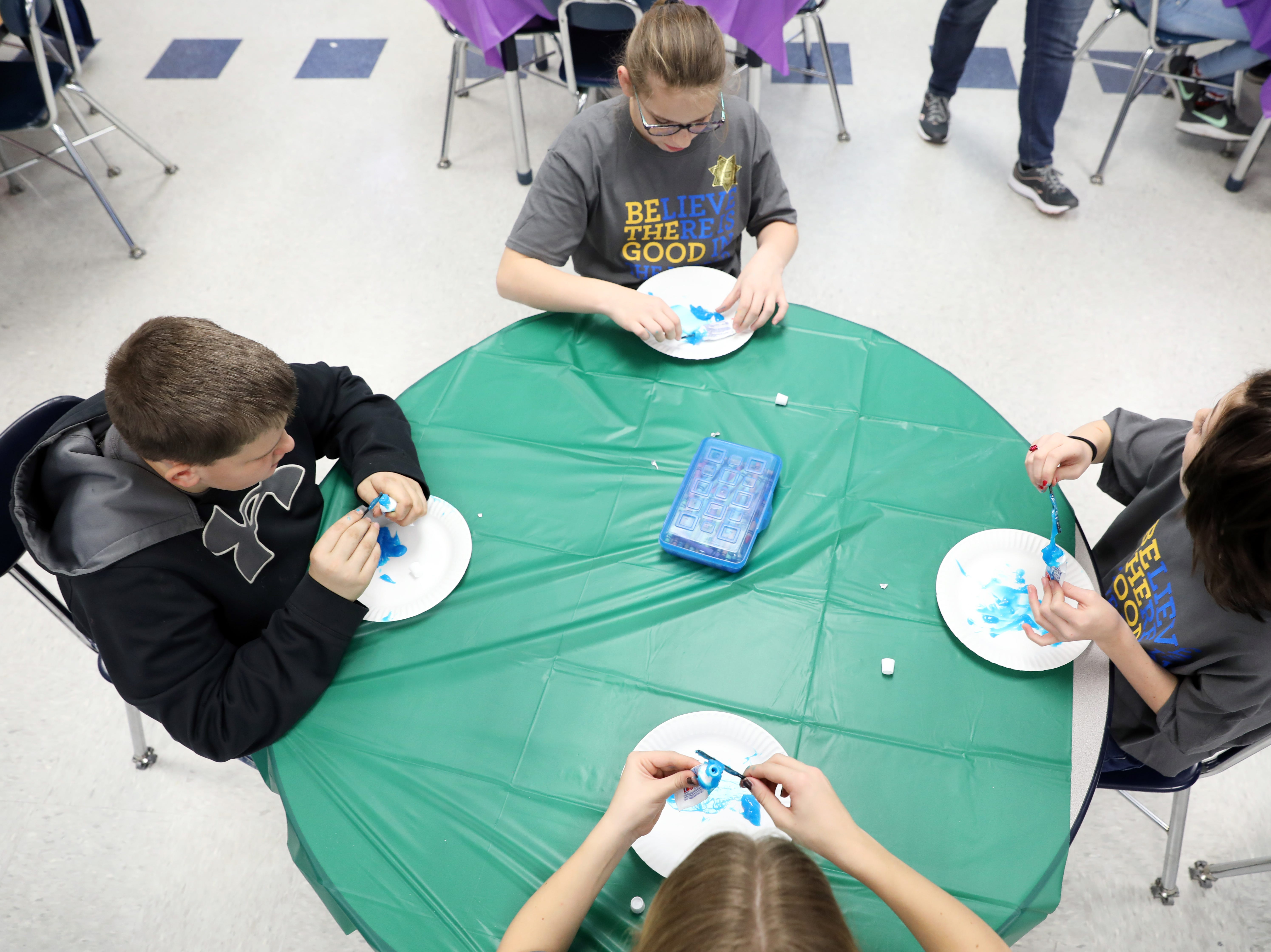 Students try to get toothpaste back in the tube during Roseville Elementary School's dude. be nice program.