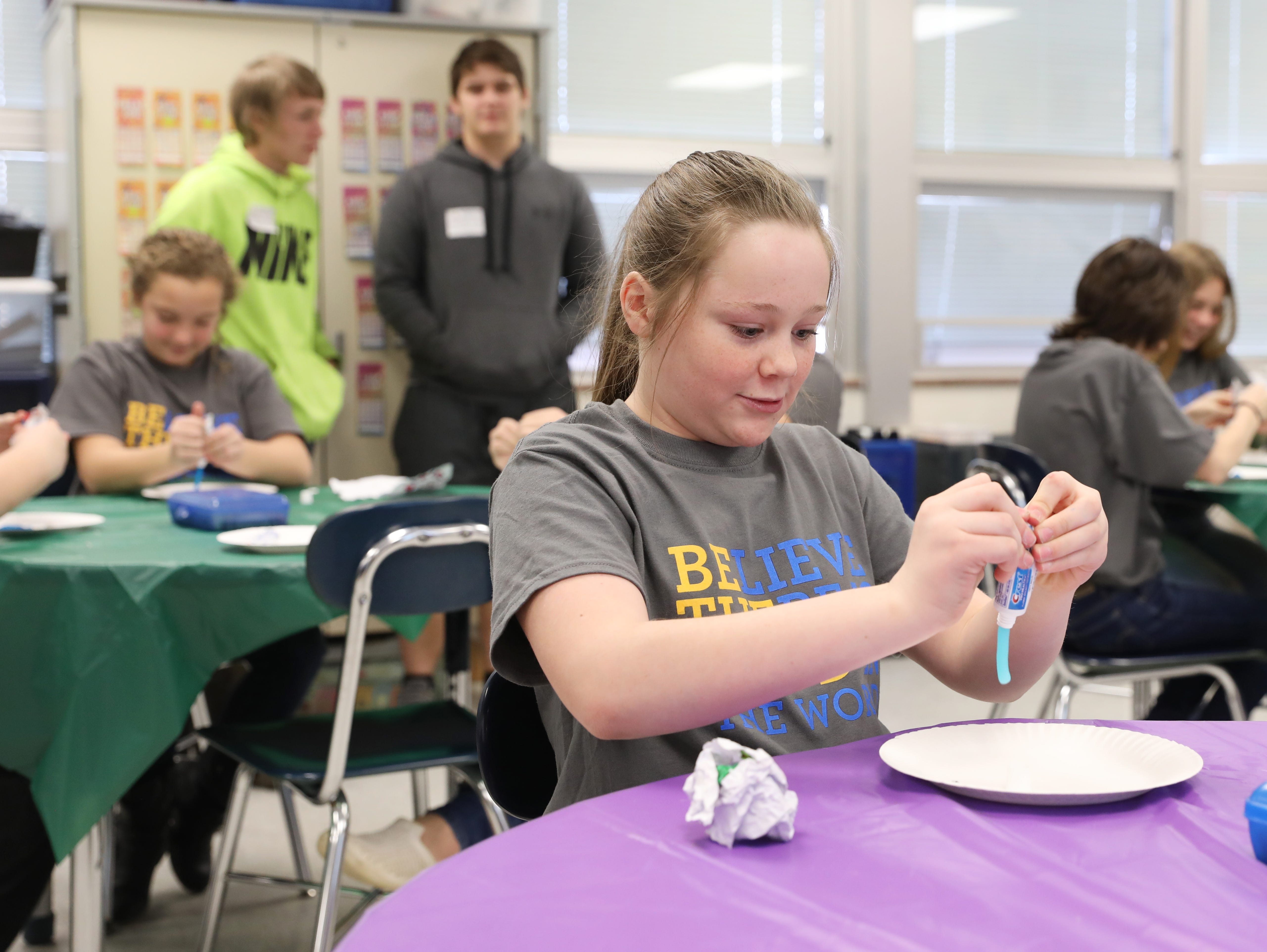 Lillie Rosser, a sixth grader at Roseville Elementary School, sqeezes a tube of toothpaste during the schools' dude. be nice program.