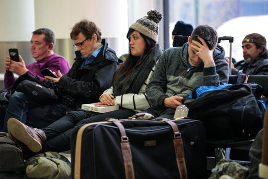 Passengers wait in the South Terminal building at London Gatwick Airport after flights resumed Dec. 21, 2018. Flights were halted again after that amid another suspected drone sighting.