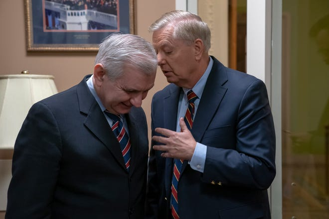 Sen. Jack Reed, D-R.I., left, and Sen. Lindsey Graham, R-S.C., members of the Senate Armed Services Committee, confer prior to a news conference to say they are disagreeing with President Donald Trump's sudden decision to pull all 2,000 U.S. troops out of Syria, at the Capitol in Washington, Thursday, Dec. 20, 2018.