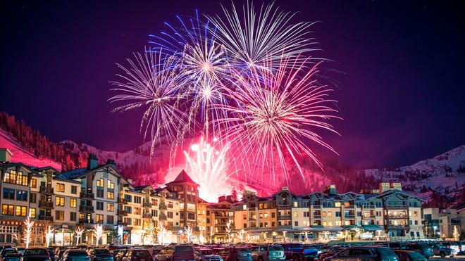 Skiers can spend the day on the slopes and then watch the sky light with fireworks and an epic torchlight parade down the mountain at Squaw Valley resort in Lake Tahoe, California.