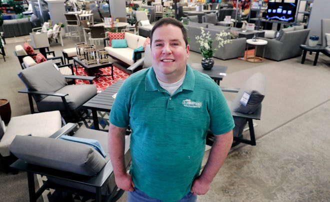 Brad Schweig, co-owner of Sunnyland Furniture, poses for a photo at his store in Dallas on Dec. 11, 2018.