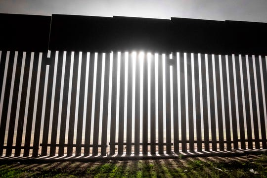 TOPSHOT - A reinforced section of the US-Mexico border fence is seen from Tijuana, Baja California state, Mexico on December 20, 2018. - Donald Trump and congressional Democrats stood at stark odds on December 20, 2018, as the president balked at a spending stopgap that contains no border wall funding, leaving the US government on the precipice of a Christmastime shutdown. (Photo by Guillermo Arias / AFP)GUILLERMO ARIAS/AFP/Getty Images ORIG FILE ID: AFP_1BR20P