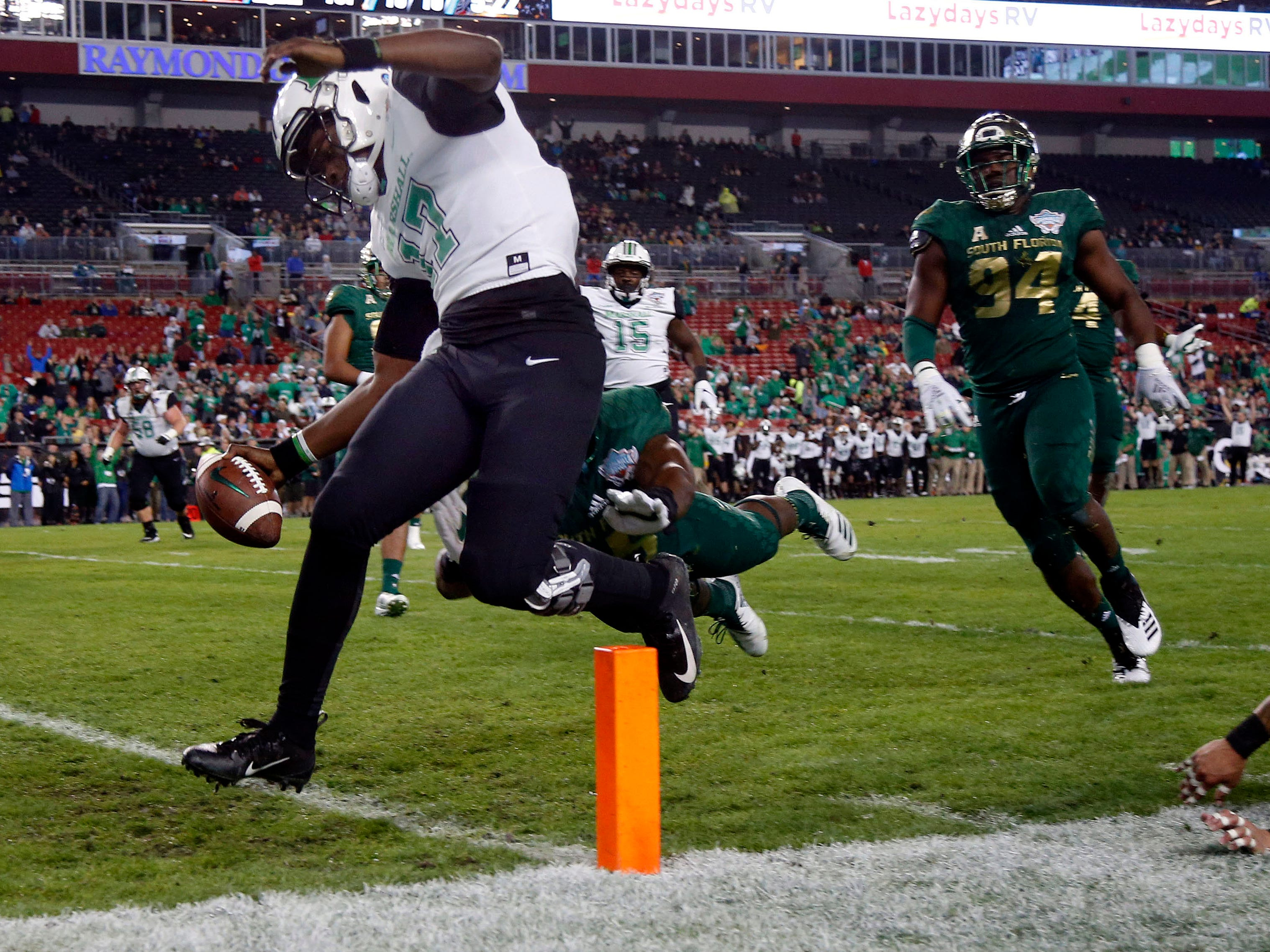 Marshall Thundering Herd quarterback Isaiah Green  runs the ball in for a touchdown against South Florida during the first quarter in the Gasparilla Bowl.