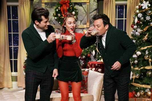 c40f6e2e0ab Miley Cyrus revamps  Santa Baby  lyrics for today