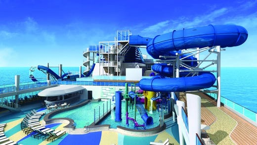 Dubbed the Aqua Park, the water slide area of Norwegian Encore rises several decks above the main pool.