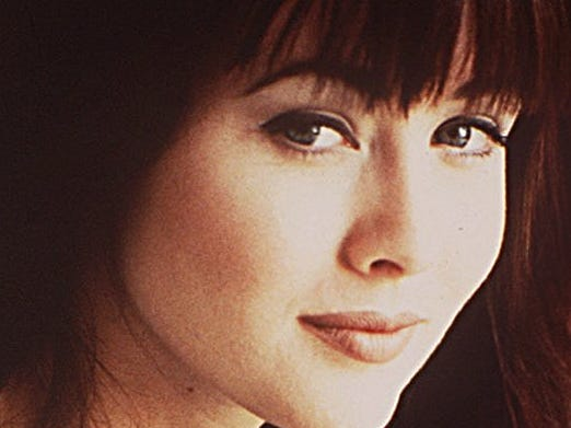"""The show began in 1990 as a fish-out-of-water story about a pair of fraternal twins whose family relocates from Minnesota to Los Angeles. Shannen Doherty, who played Brenda Walsh, was the most well-known cast member thanks to her roles in the TV series """"Our House"""" and  the1988 cult movie """"Heathers."""" She was also the first major cast member to leave """"90210."""" Doherty was written out during Season 4 after some behind-the-scenes drama. and her  character left to study drama in London."""