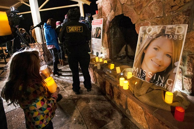 In this Dec. 13, 2018 file photo, community members hold a candlelight vigil for Kelsey Berreth under the gazebo of Memorial Park in Woodland Park, Colorado.