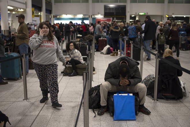 Passengers wait for announcements at London's Gatwick Airport on Dec. 20, 2018.