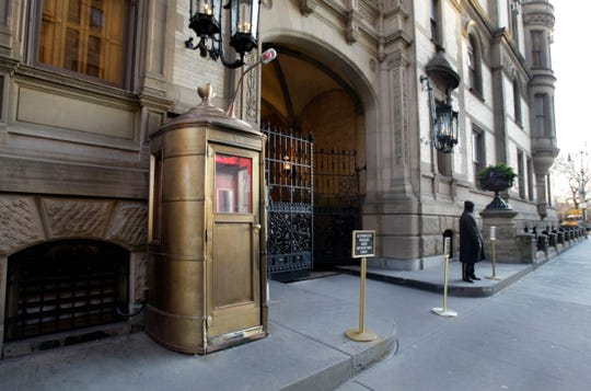 On Dec. 8, 2010, a doorman stands outside the Dakota on New York's Upper West Side, where John Lennon was shot in 1980.