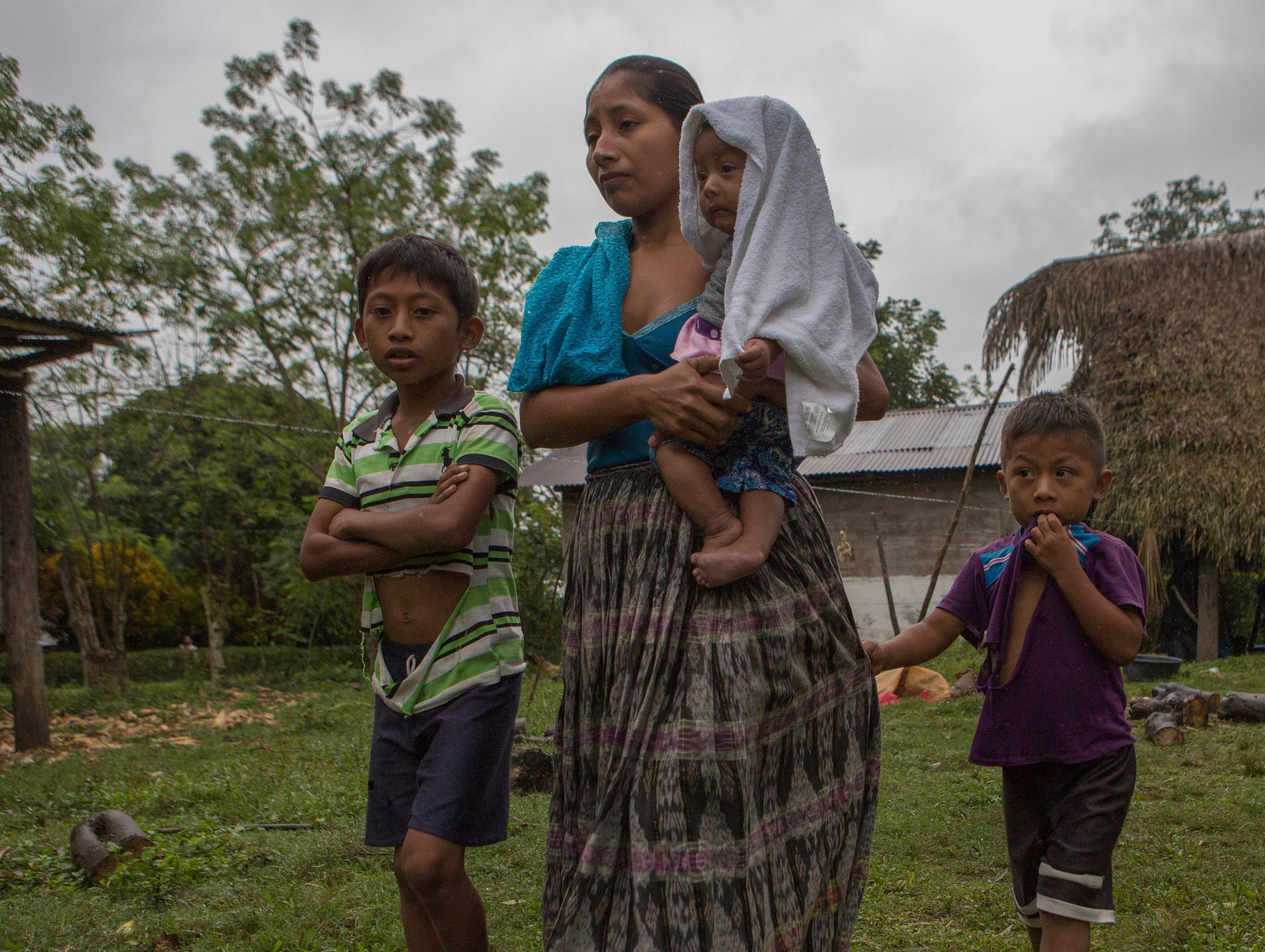 Dec. 15, 2018: Claudia Maquin, 27, walks with her three children, Abdel Johnatan Domingo Caal Maquin, 9, left, Angela Surely Mariela Caal Maquin, 6 months, middle, and Elvis Radamel Aquiles Caal Maquin, 5, right, as they leave Domingo Caal Chub's house, Claudia's father-in-law, in Raxruha, Guatemala.Claudia Maquin's daughter, 7-year-old Jakelin Amei Rosmery Caal, died in a Texas hospital, two days after being taken into custody by border patrol agents in a remote stretch of New Mexico desert.
