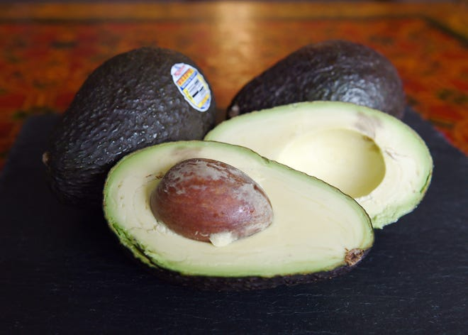 """This January 22, 2015 file photo shows Hass avocados in Los Angeles, California. President Barack Obama dipped into what has become a raging national debate pitting traditionalists against innovators when making guacamole, the mashed avocado treat that has become a favorite American indulgence. The New York Times published a recipe in its weekly """"Food"""" section July 1, 2015 in which it recommends adding a healthy portion of peas to the avocados -- a move the author freely acknowledged was """"radical."""" The peas add intense sweetness and a chunky texture to the dip, making it more substantial on the chip,"""" food writer Melissa Clark wrote in her column. Guacamole lovers across the United States -- including Obama -- turned up their noses at the thought."""