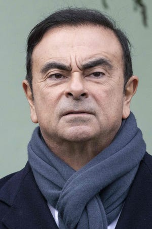In this file photo taken on November 8, 2018 Renault CEO Carlos Ghosn waits for the French President to arrive for a visit of the Renault factory in Maubeuge northeastern France. Prosecutors have rearrested former Nissan boss Carlos Ghosn over fresh allegations of breach of trust, local media said on December 21, 2018, in the latest twist to a rollercoaster saga.
