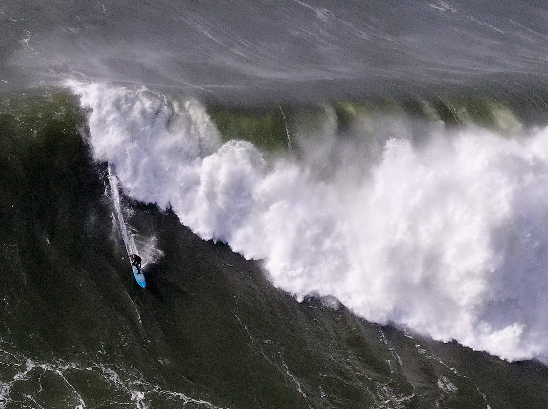 Dec. 17, 2018: A surfer rides a wave at Mavericks in Half Moon Bay, Calif. A giant swell brought waves of up to 50 feet high to Northern California.