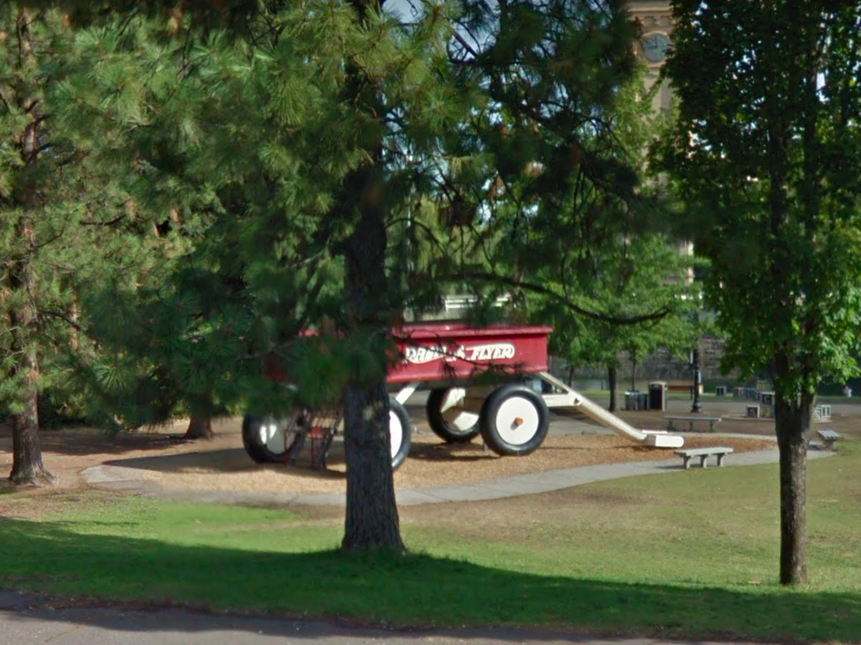 """Washington: Travelers will be pleased to find the """"World's Largest Radio Flyer"""" nestled behind the trees at Riverfront Park in Spokane."""