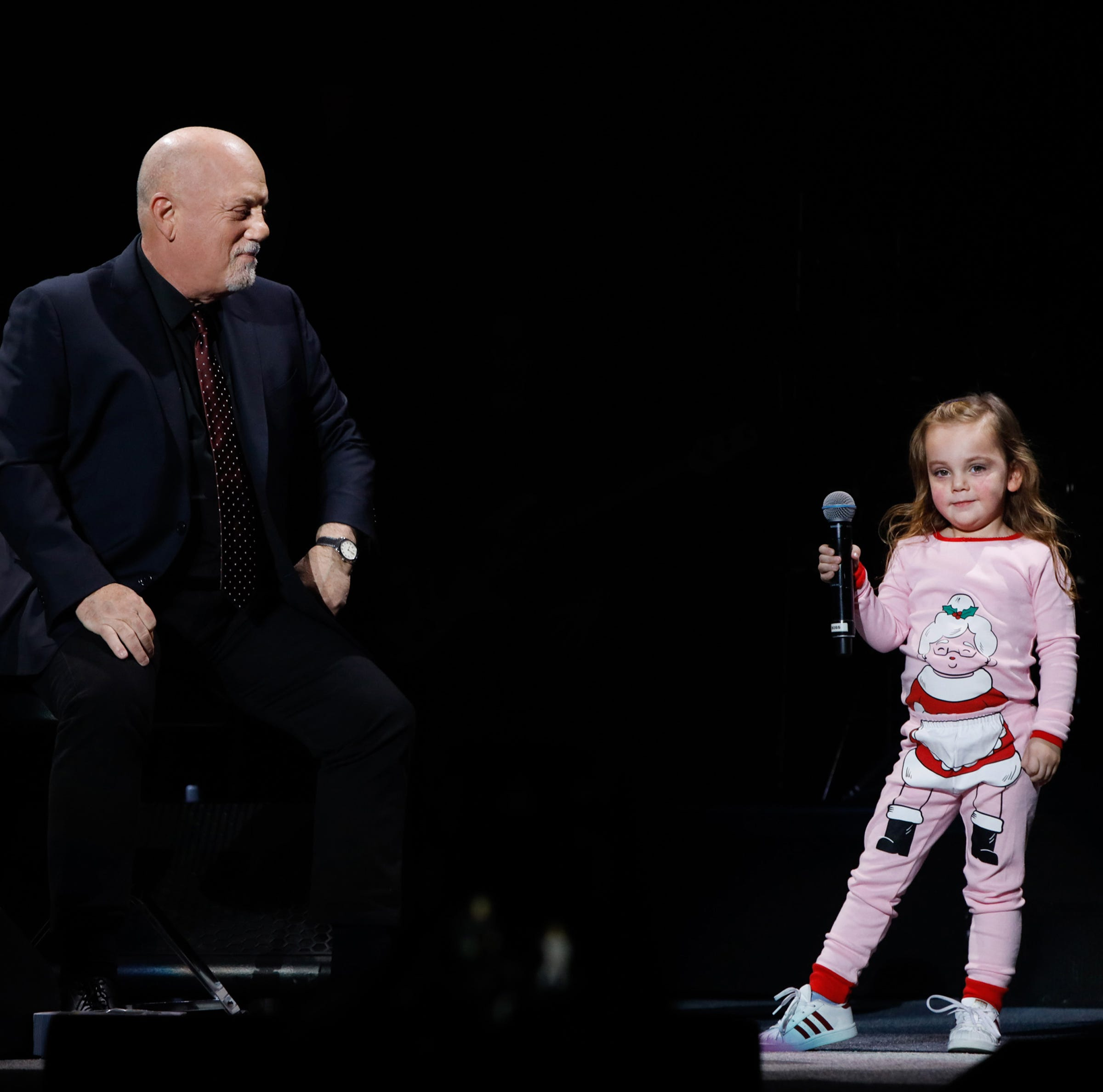 "Della Rose Joel, age 3, joins her father Billy Joel onstage for a duet of Della's favorite song ""Don't Ask Me Why"" during Billy Joel's sold out show  at Madison Square Garden on December 19, 2018 in New York City."