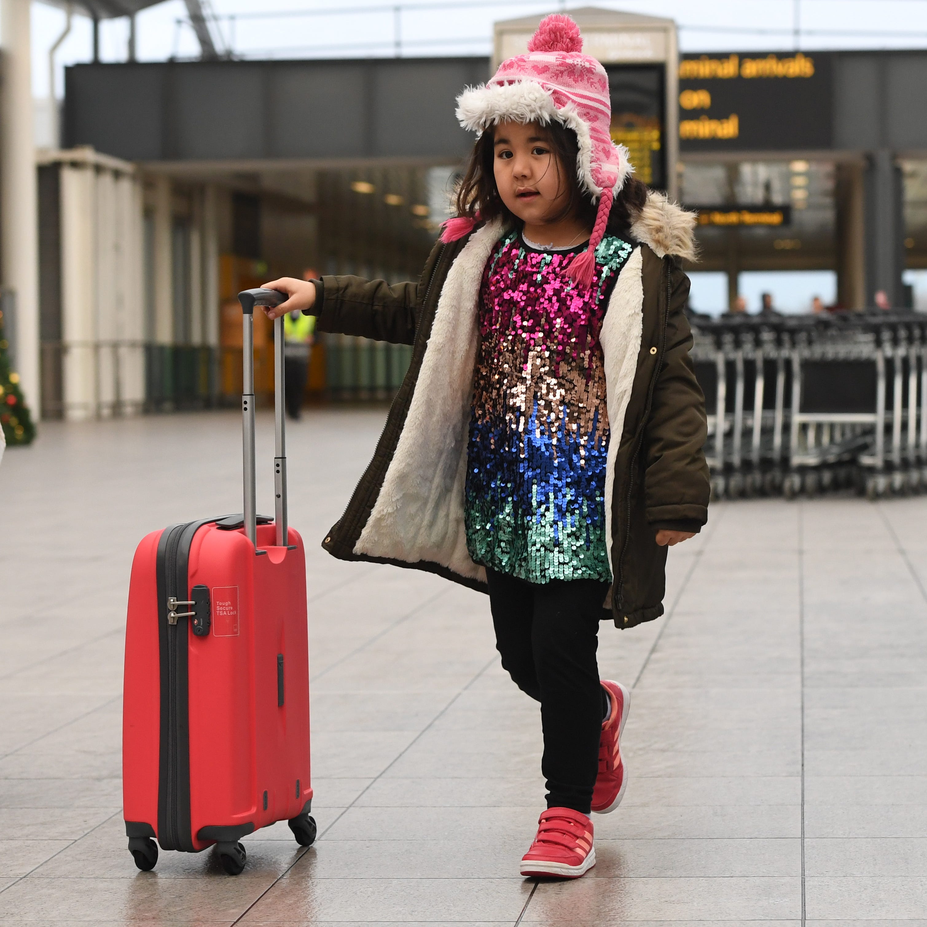A passenger arrives with her luggage at London's Gatwick airport on Dec. 21, 2018.