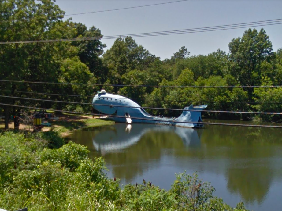 """Oklahoma: With a sign clearly labeling it as a """"Route 66 Roadside Attraction"""", this blue whale has been attracting visitors since 1972. Yes, it is also wearing a baseball cap."""