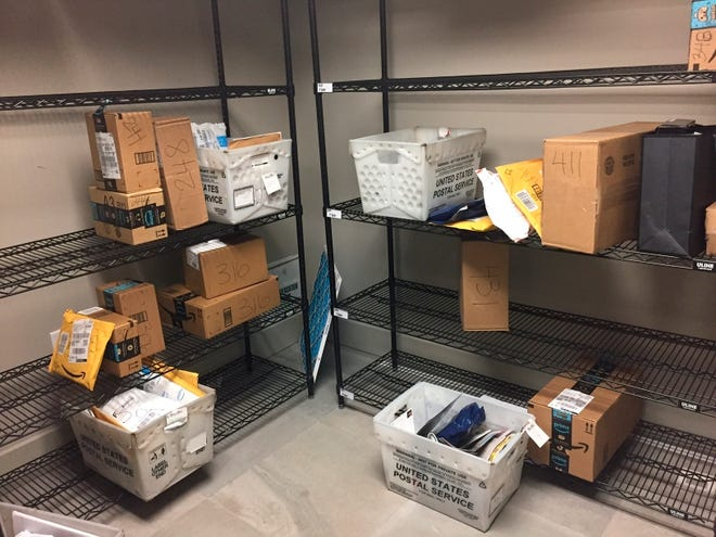 Packages from internet retailers are delivered with the U.S. Mail in an apartment building mail room in Washington on April 13, 2018.
