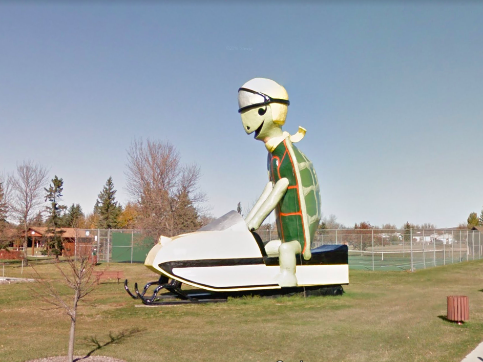 North Dakota: Near the Turtle Mountains stands Tommy the Turtle. He is 30 feet tall, rides a 34-foot-long snowmobile, and was created by a man called Boots Reynolds.