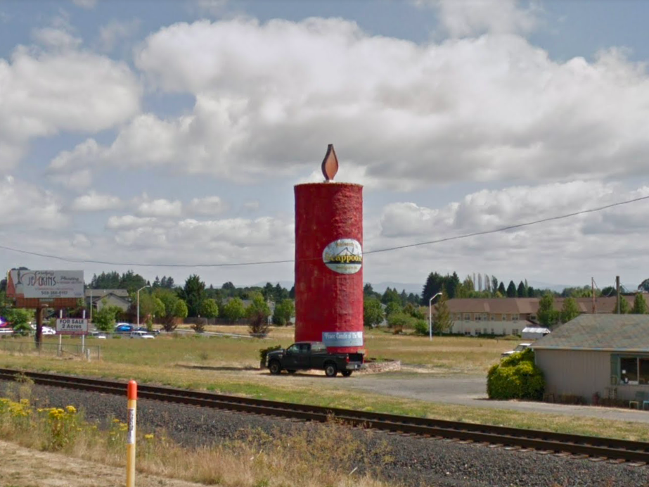 """Oregon: What was once a large grain silo is now """"The Peace Candle of the World"""" and a welcome sign to Scappoose."""