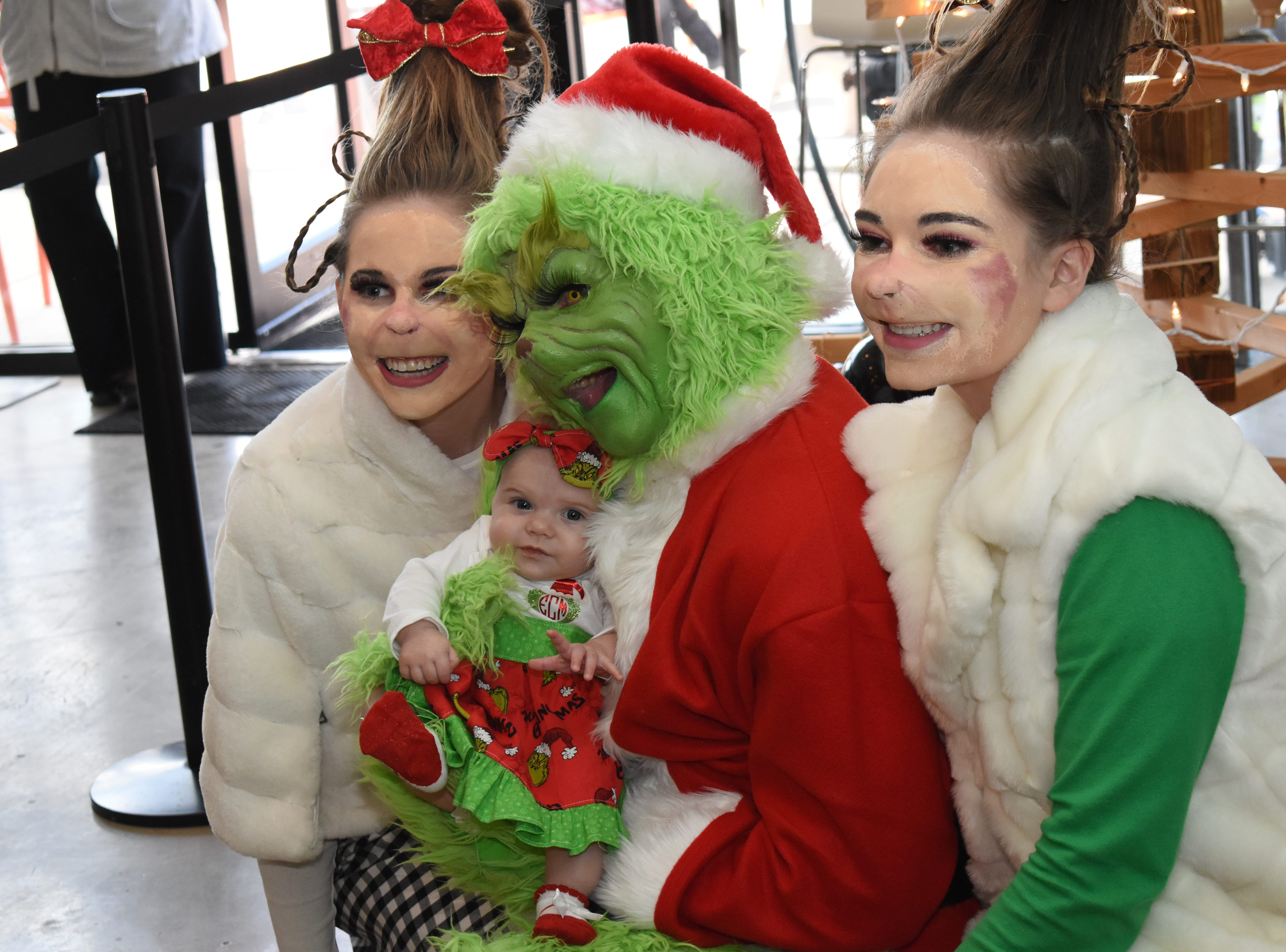 "The Grinch and two Whos, characters created by the late author Dr. Seuss, visited with patrons at Spoons Frozen Yogurt located at 2385 North MacArthur Drive Saturday, Dec. 22, 2018. The Grinch was portrayed by Matt Hughes of New Orleans and the Whos portrayed by Pineville High School student Camille Robinson and Alexandria Senior High School student Allie Ainsworth. Davin Ainsworth, owner of Spoons Frozen Yogurt along with his wife Melissa, said this is the first time they've had the Dr. Seuss characters. In the past other characters such as superheroes or Disney's ""Frozen"" characters have visited with patrons. Ainsworth said to keep up with their Facebook page, Spoons Froze Yogurt, or follow them on Instagram to find out what other characters will be visiting the shop."