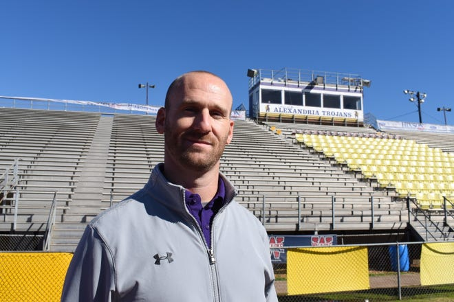 Alexandria Senior High School football coach Thomas Bachman has a 35-19 record in five seasons with the Trojans.