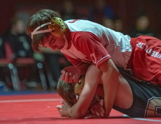 Ocean's Will Tisony rides Point Pleasant Boro's Lucas Sabo during the 120-pound bout. Tisony recorded an 11-2 major decision win