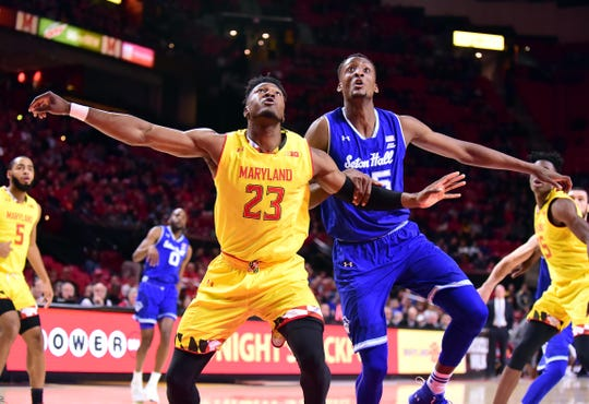 Seton Hall Pirates center Romaro Gill (35) fights for a rebound with Maryland Terrapins forward Bruno Fernando (23)