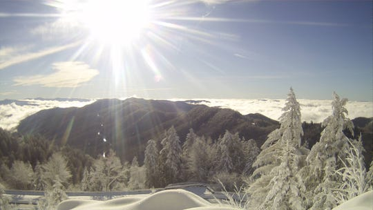 The Great Smoky Mountains National Park will remain open, but some services will be curtailed during the federal government's partial shutdown. This is a webcam image from the park's camera at Newfound Gap on Saturday.